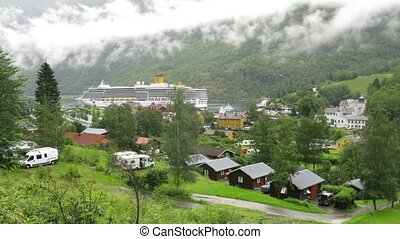 Big cruise liner stationed at bay in Flom village