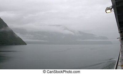 Silhouette of beautiful fjord in mist, time lapse -...