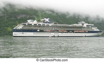 Celebrity Cruises liner at bay - GEIRANGER, NORWAY- JUNE 28:...