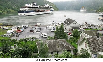 Traffic in port of little Geiranger village, time lapse