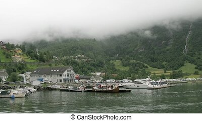 Boats stay at bay in Geiranger village, time lapse