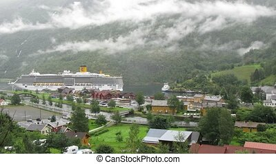 Cruise liner stationed at bay in Flom village, time lapse -...