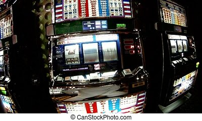 Man presses button on slot machine, close-up
