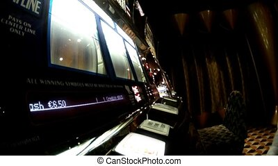 Man sits at slot machine and presses button, close-up, side...