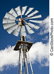 Windmill and Blue Sky - Old west-style farm windmill for...