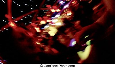 Happy couple dances on dance-floor in night club