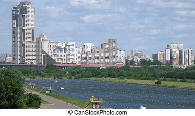 Rowing competition in front of tall buildings in Moscow,...