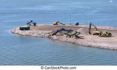 Construction works in port on sunny weather - HELSINKI,...