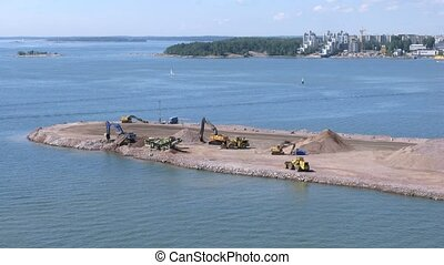 Construction works in Helsinki port on sunny weather, time...