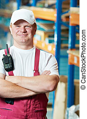 caucasian young manual worker in warehouse
