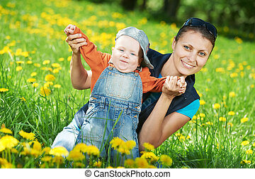 Mother playing with child boy