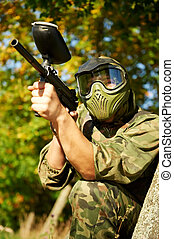 paintball player aiming with marker