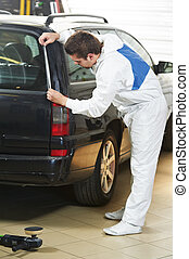 auto mechanic protecting car before polishing - auto...
