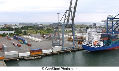 Loader trucks operate at port, time lapse - Loader trucks...