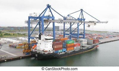 Cranes load ship in port - COPENHAGEN, DENMARK - JULY 12:...