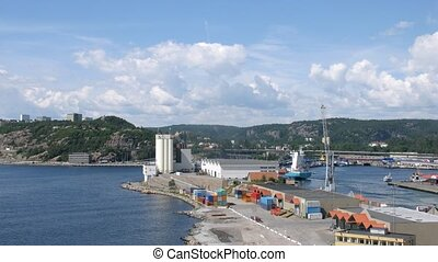 Freight ship leaves docks in Kristiansand, time lapse