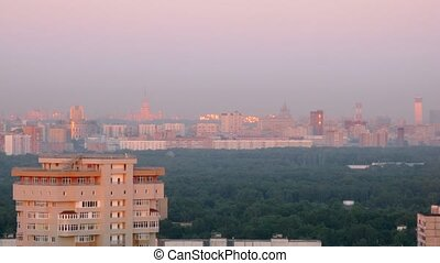 Sun rays left highlights in windows of Moscow skyscrapers, view from roof, time lapse