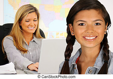 Girl At School - Teacher and student at their school in a...