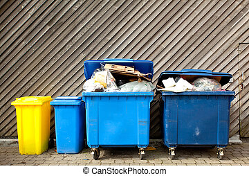 Large wheelie bins - overfilled trash of large wheelie bins...