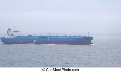 Tanker runs parallel to cruise liner
