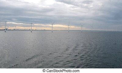 Pass by row of wind turbines, time lapse - Pass by row of...
