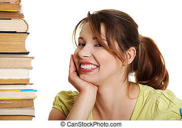 Young caucasian woman (student) with books