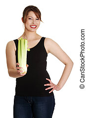 Young woman with celery