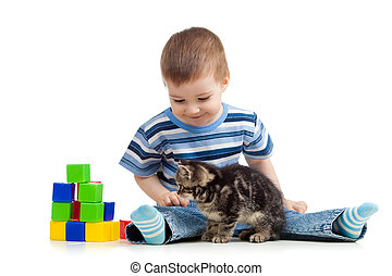 kid playing toy blocks with cat pet