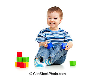 kid playing toy blocks