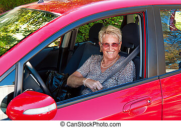 as senior drivers in the car. - elderly woman in a seat belt...