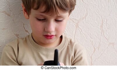 Little boy hold phone and try to speak