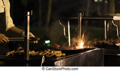 BBQ meat on grill with flames