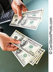 Counting money - Busineswoman hand counting US dollar bills,...