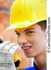 apprentice trainee construction worker on building site with...