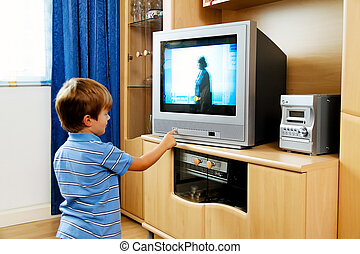 small children watching television