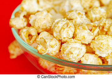 Popcorn in the bowl on red backgrond