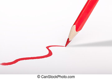 Red pencil making a stroke over white Background