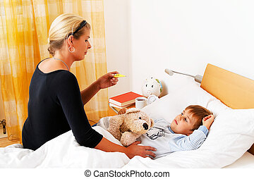 mother and sick child in bed.