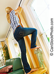 housewife with curtains accidents in the home households - a...