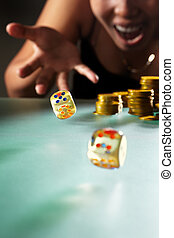Throwing dices - Young Asian woman throwing the dices for...