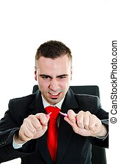 Furious angry businessman breaking a pencil