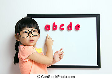 Back to school - School girl wears a big spectacles posing...
