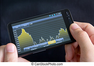 Smart phone with stock chart - Man analyse stock market...