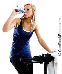 break in training - Blonde fitness woman drinking water or...