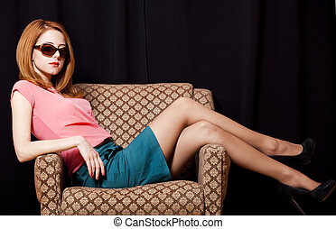 Redhead girl in armchair 70s