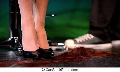 Clipped hair lie down near womens feet in shoes, then legs...
