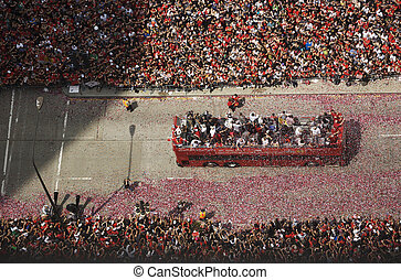 Crowd Celebrating During Parade - Crowd cheering during...