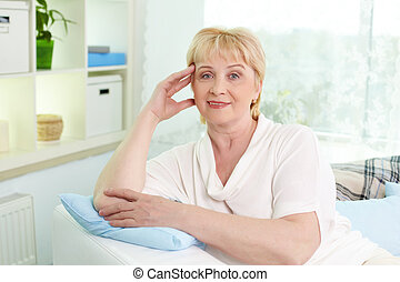 Staying at home - Portrait of mature woman looking at camera...