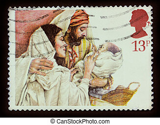 UNITED KINGDOM - CIRCA 1984: A stamp printed in the United Kingdom shows a Christmas postage stamp with Mary, Joseph and Baby Jesus, circa 1984