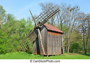 Antique wooden windmill at ethnographic museum,...